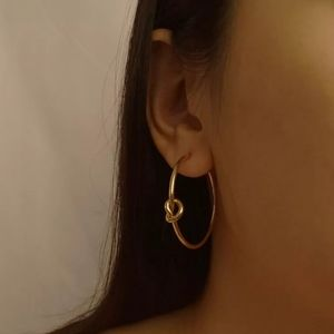 3/$23 Knot Hoop Earrings in Gold
